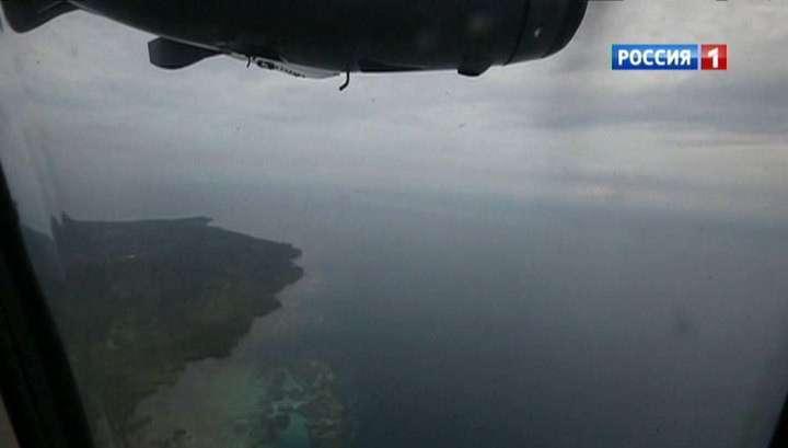 Трёхметровые волны остановили операцию по поиску тел пассажиров AirAsia