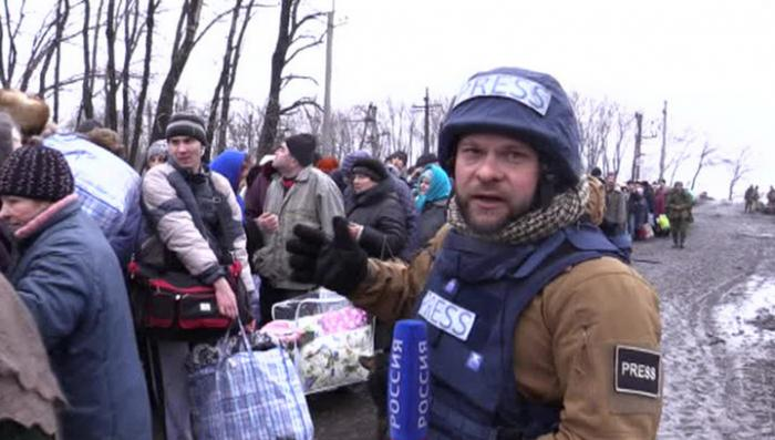 Эвакуация под обстрелом. Репортаж Евгения Поддубного из Углегорска