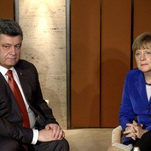 Меркель, Порошенко и Байден начали переговоры по Украине