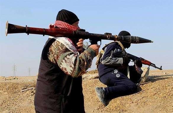 Ирак обвинил в Британию в поставках оружия ИГИЛ. Кэмерон поддерживает террористов?. Боевики ИГИЛ на позиции