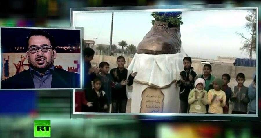 Иракского журналиста, бросившего ботинки в Жору Буша-мл., избивали и пытали