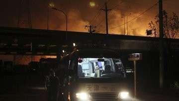 На месте взрыва и пожара в Тянцзине