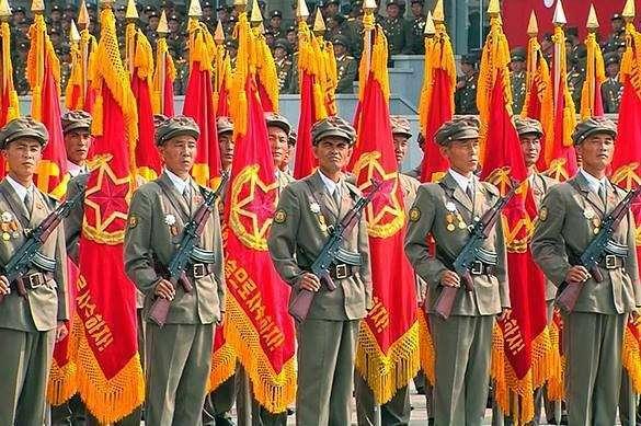 северокорейцы под знаменами