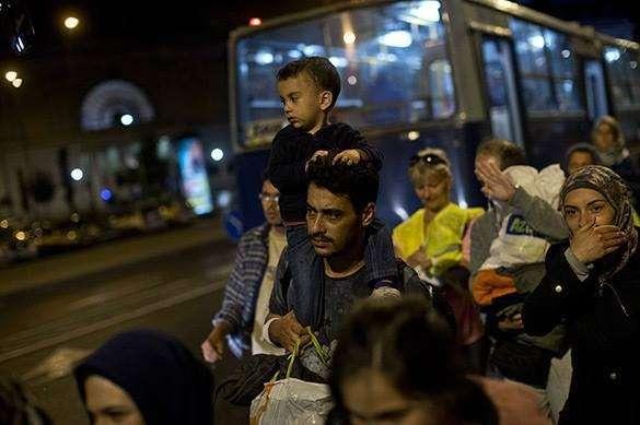 Штайнмайер: Если не снизить поток беженцев, Германия захлебнется