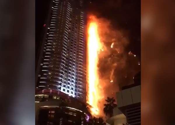 Огонь почти полностью охватил здание отеля в центре Дубая