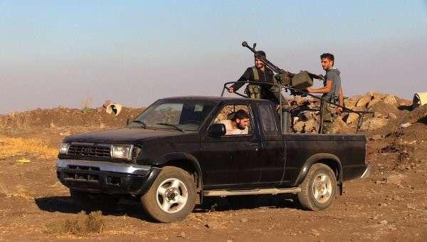 Сирийское нацополчение ведет бой с вооруженными бандформированиями на границе провинций Дераа и Кунейтра