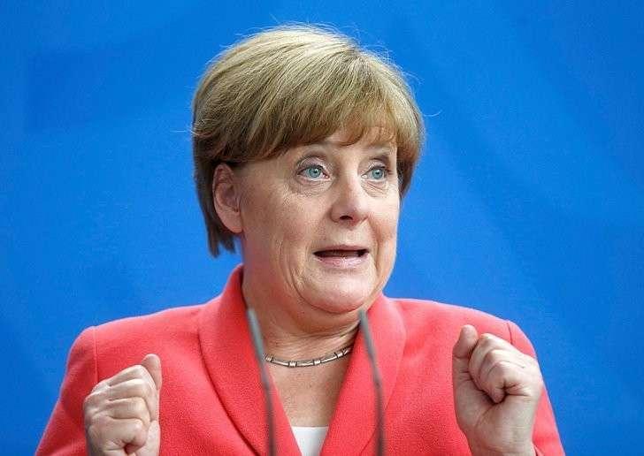Меркель сделала больше всех для привлечения волны мигрантов с разоренного Ближнего Востока в Европу Фото: REUTERS