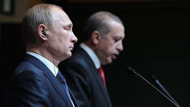 Президент России Владимир Путин и президент Турецкой республики Реджеп Тайип Эрдоган на итоговой пресс-конференции в Анкаре. Архивное фото