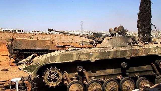 Бронетехника сирийской армии, поврежденная при штурме школы ВВС на юге  Алеппо. Архивное фото