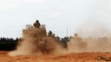 Израильские бронетранспортеры возле сектора Газы. Архивное фото