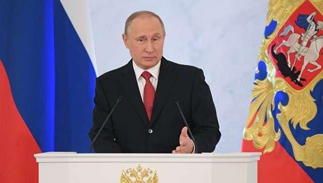 Президент РФ Владимир Путин выступает с ежегодным посланием Федеральному Собранию в Георгиевском зале Кремля. Архивное фото