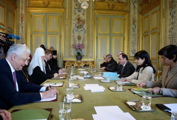 Московский главпоп поехал во Францию и встретился с уходящим презиком Олландом