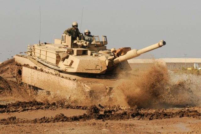 США: новый танк Абрамс M1A2SEPv3 против русского Т-14 «Армата». Кто победит?