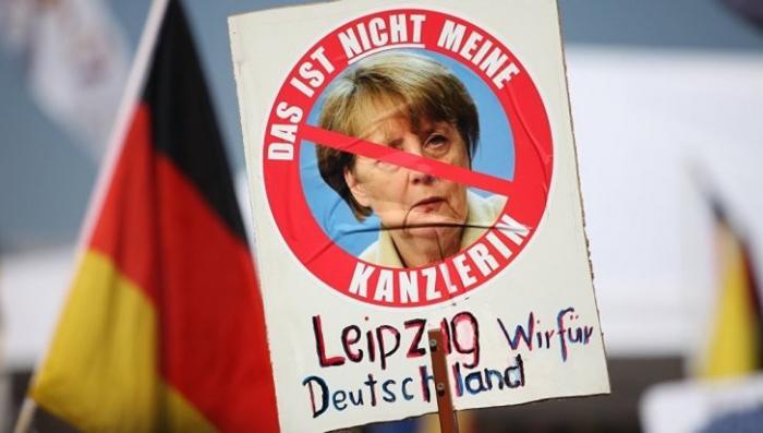 Мигранты в Европе: за что фрау канцлера ФРГ обвиняют в госизмене?