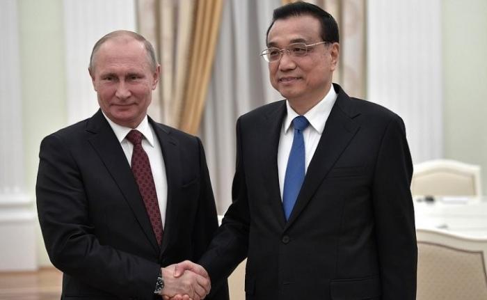 Владимир Путин принял в КремлеПремьера Госсовета КНРЛи Кэцяна