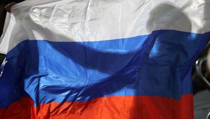 В олимпийском Пхенчхане у российского болельщика пытались отобрать флаг