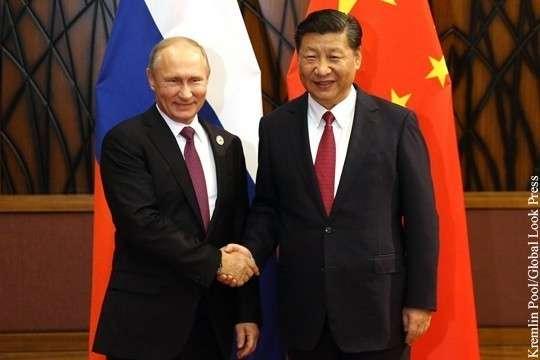 Владимир Путин поздравил Си Цзиньпина с переизбранием