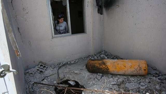 Разрушенный дом в Думе в пригороде Дамаска, запрещенный к посещению экспертами ОЗХО. Апрель 2018