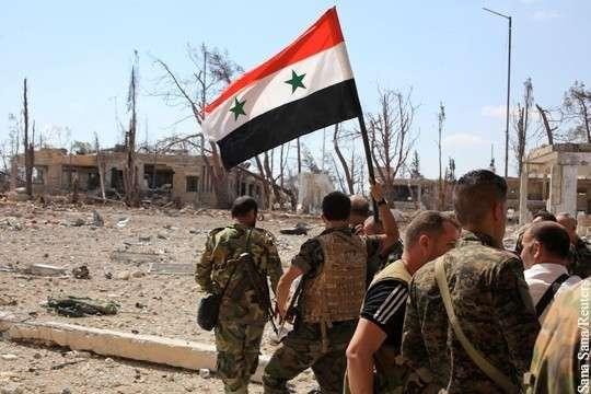 Сирия. Правительственная армия подняла флаг в месте, где началась террористическая война