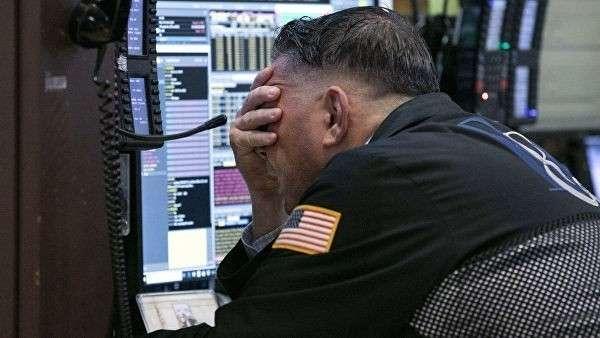 Трейдер на Нью-Йоркской фондовой бирже. 26 октября 2018