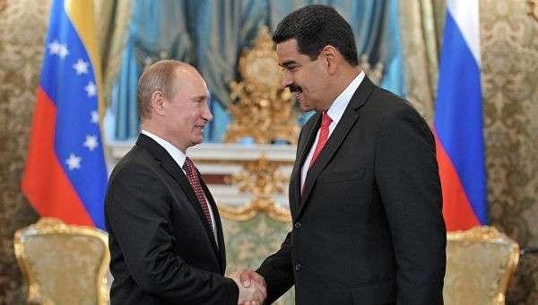 Президент России Владимир Путин (слева) и президент Боливарианской Республики Венесуэла Николас Мадуро Морос. Архивное фото