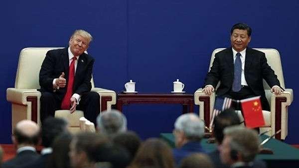 Президент США Дональд Трамп и президент Китая Си Цзиньпин во время делового мероприятия в Большом зале народа в Пекине