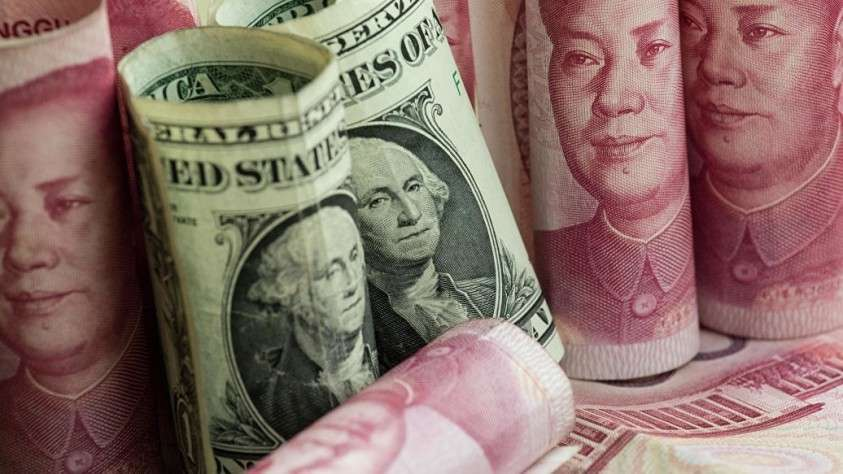 Банк Китая резко ослабил курс юаня к доллару
