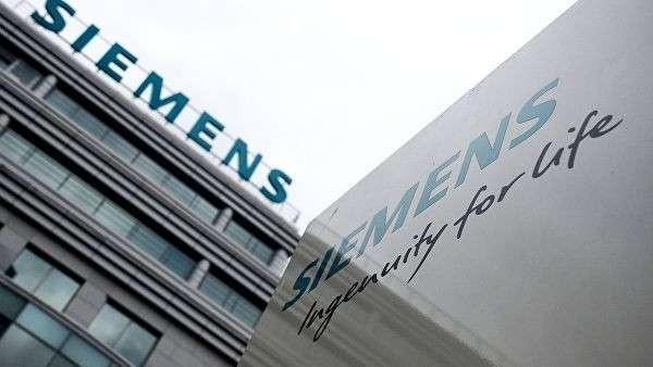 Вывеска на здании компании Siemens в Москве