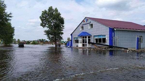 Затопленная улица в городе Тулун в Иркутской области