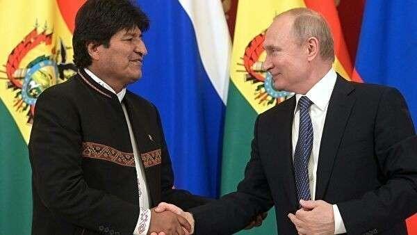 Президент РФ Владимир Путин и президент Боливии Эво Моралес на совместной пресс-конференции
