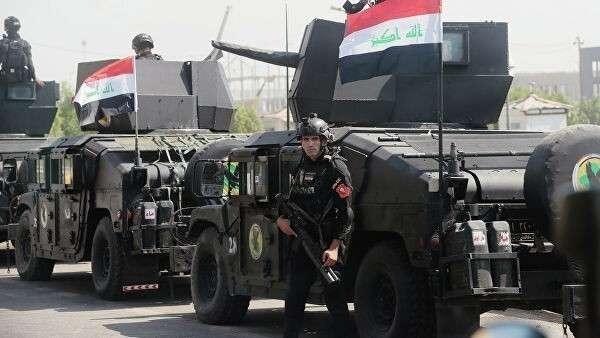 Бойцы спецподразделения по борьбе с терроризмом и военнослужащие на улице Багдада