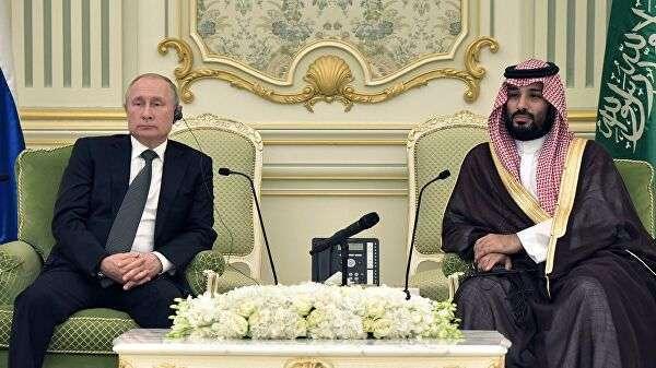 Президент РФ Владимир Путин и наследный принц Саудовской Аравии, министр обороны королевства Саудовская Аравия Мухаммед бен Сальман аль Сауд во время встречи