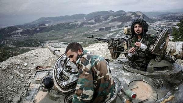Танкисты правительственных войск сирийской армии в провинции Латакия