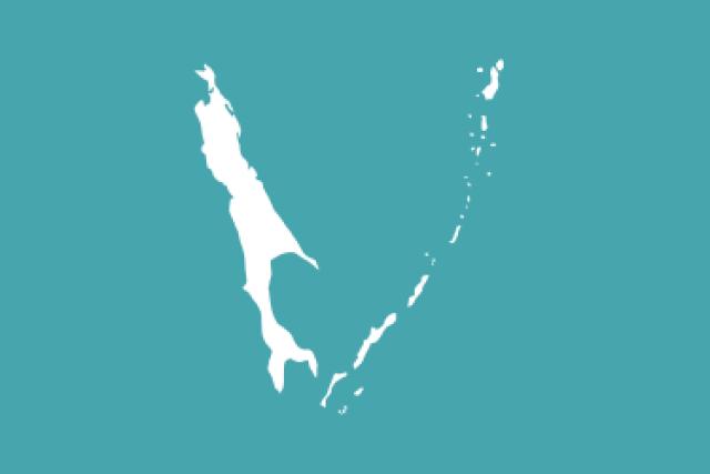 Единый и неделимый Сахалин и единые и неделимые Курильские острова на официальном флаге Сахалинской области России